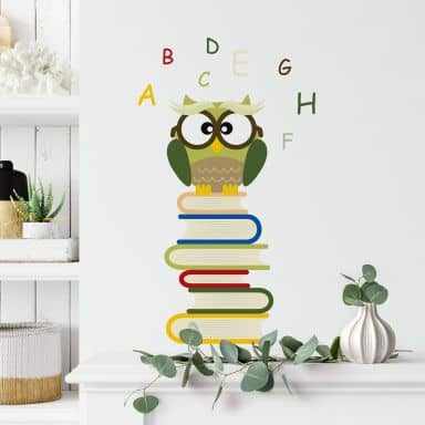 Sticker mural - Hibou sur livres