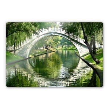Glasbild Brücke am Fluss