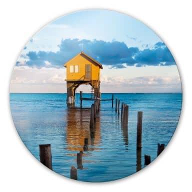 Glasbild Haus auf dem Meer - rund