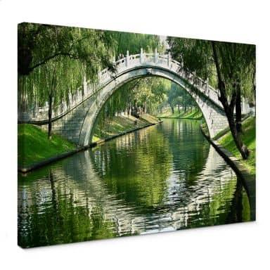 Leinwandbild Brücke am Fluss