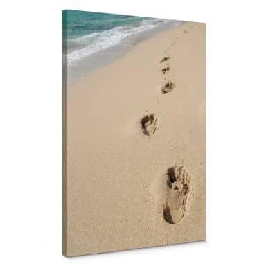 Leinwandbild Fußspuren im Sand