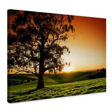 Leinwandbild Sonnenuntergang über den Hügeln