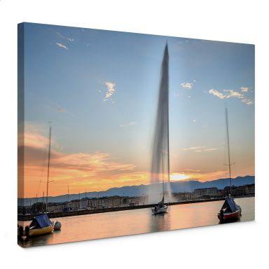 Leinwandbild Wasserfontäne im Genfer Sonnenuntergang