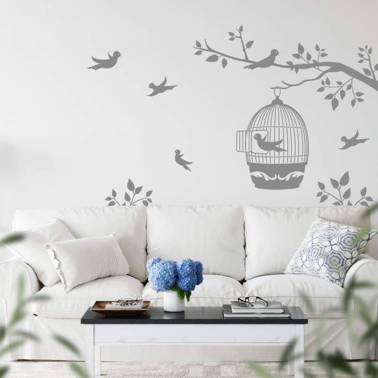 Sticker mural - Silhouette d'une branche avec cage